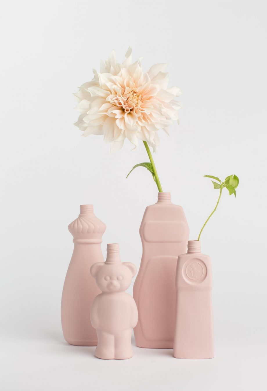 group photo in pink vases