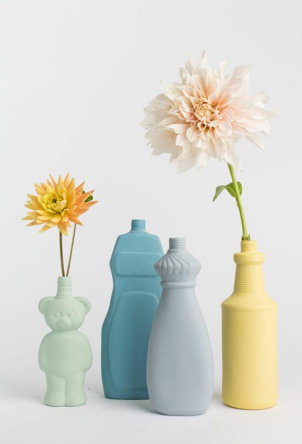group photo four bottle vases